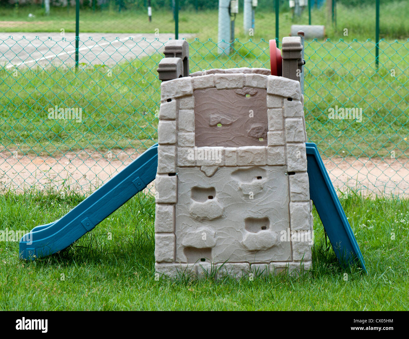 Toy house with slide - Stock Image