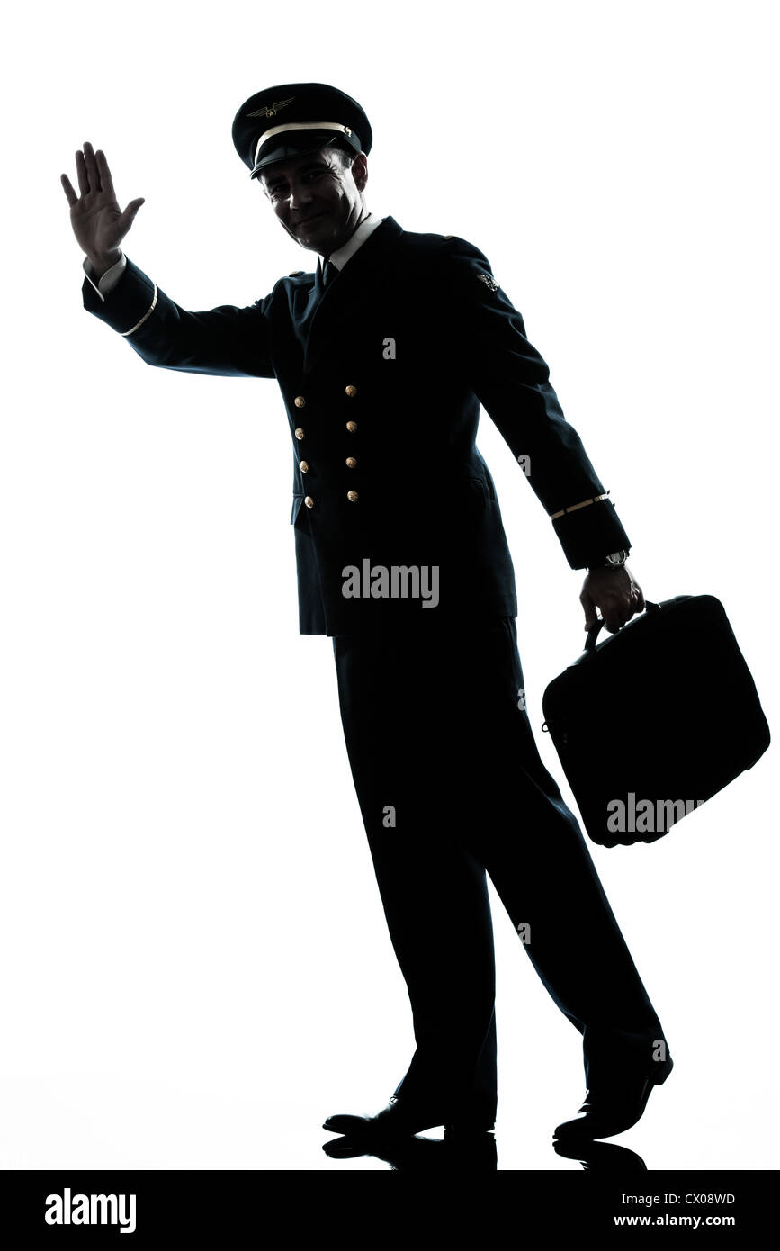 one caucasian man in airline pilot uniform  in studio isolated on white background Stock Photo