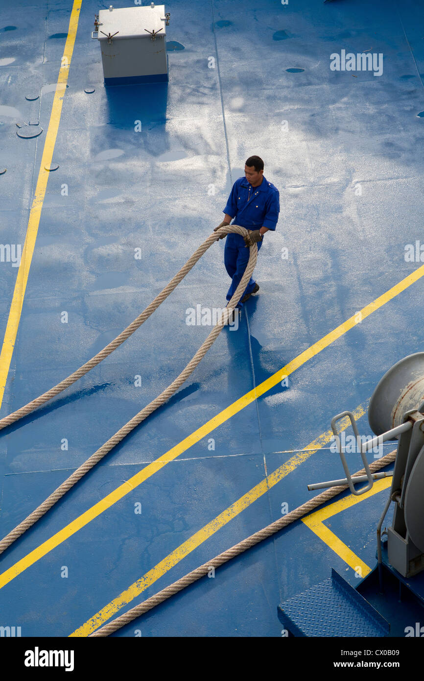 deck hand ship pulling uk mooring line rope hauser Stock Photo