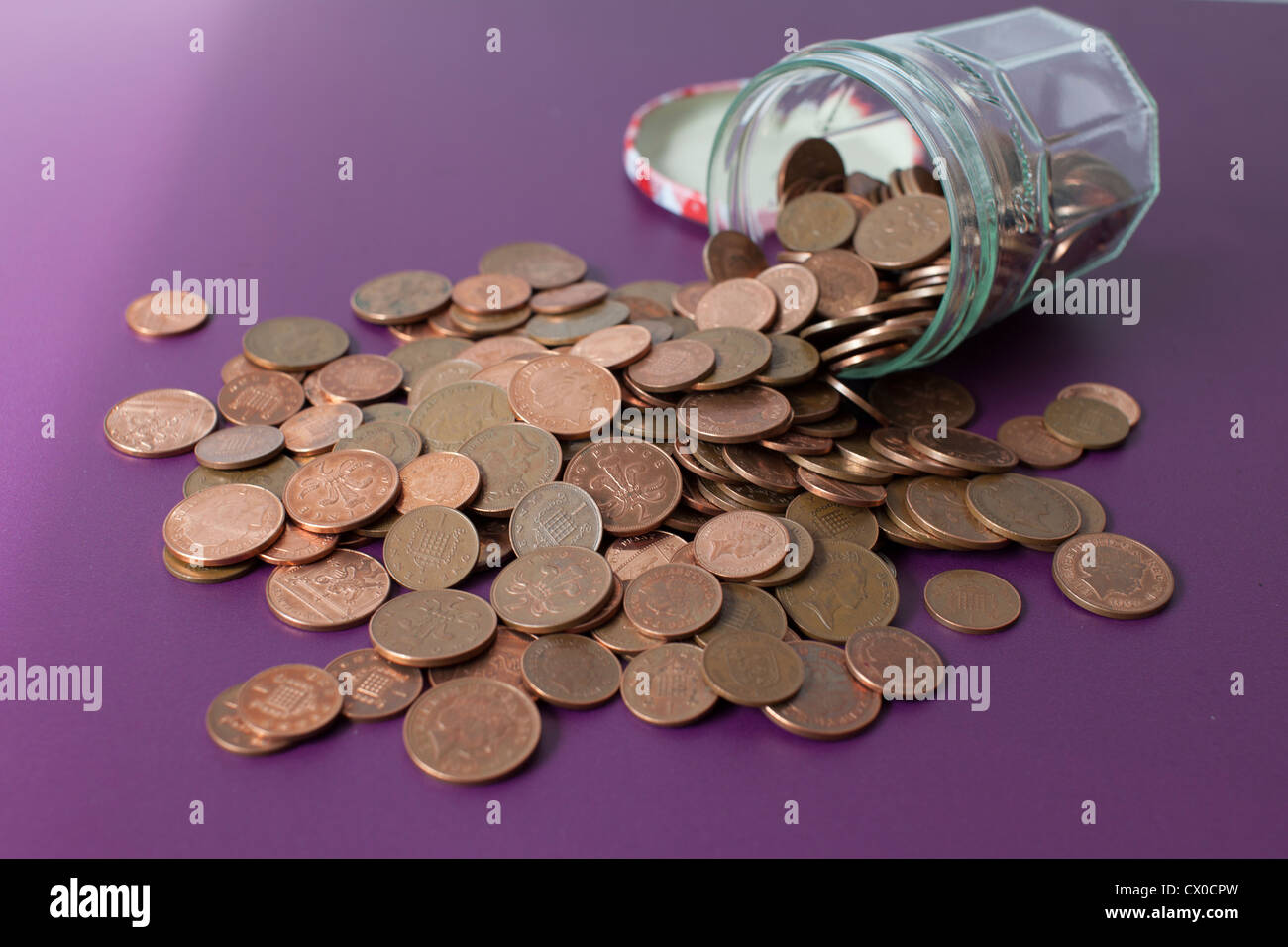 Jar full with pennies - Stock Image