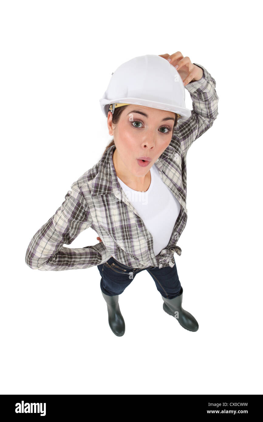 Confused female construction worker - Stock Image