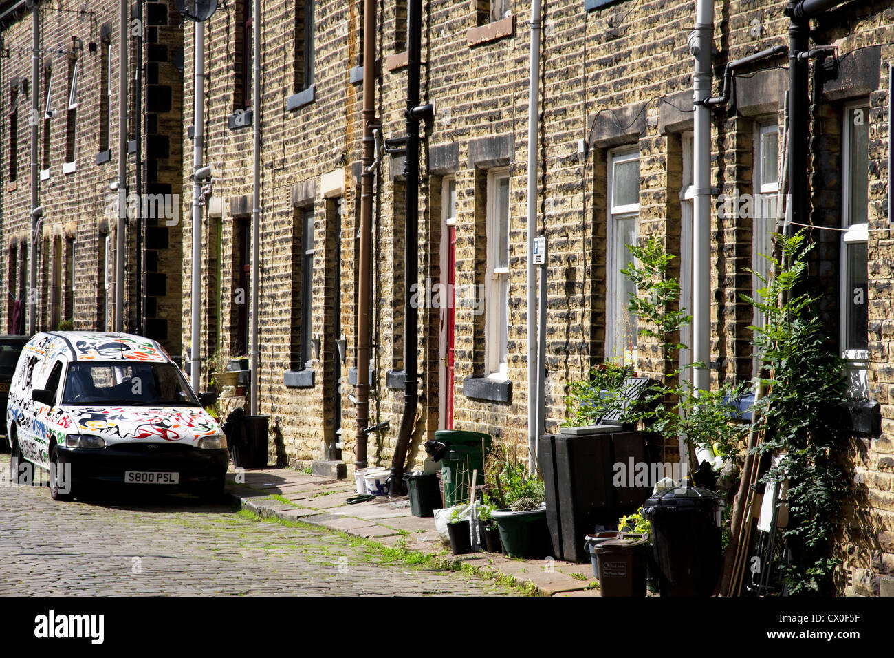 Back to Back Terraced houses (+ painted van) on cobbled street, Hebden Bridge, West Yorkshire, England, UK - Stock Image