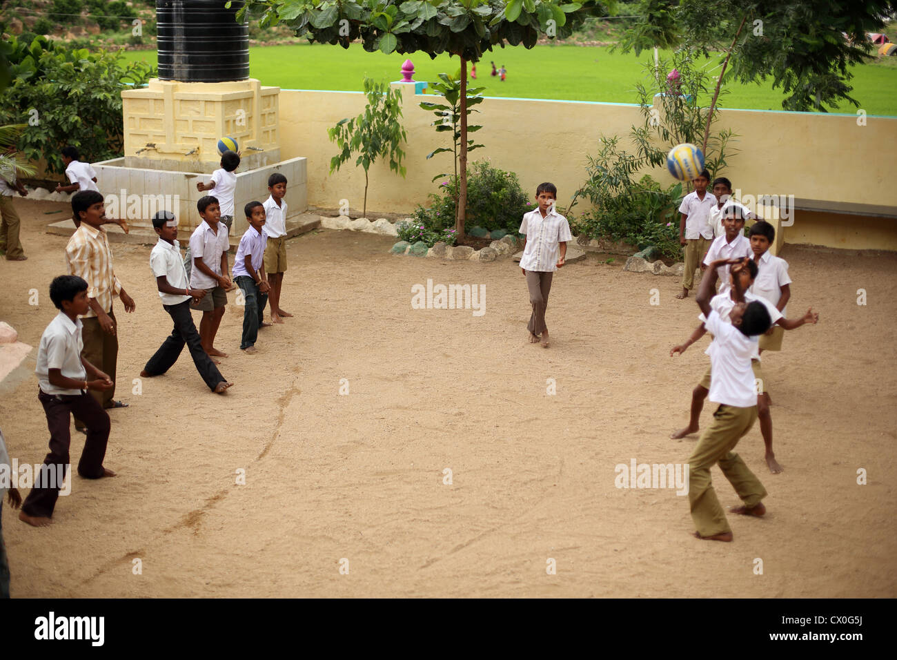 Indian school children playing volleyball Andhra Pradesh South India - Stock Image