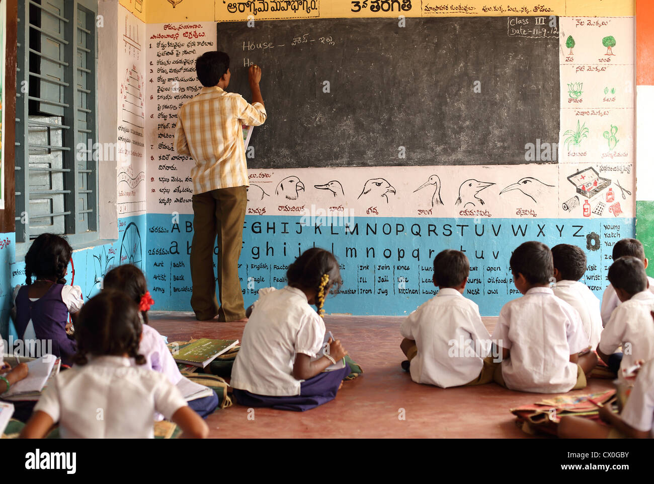 Indian school teacher with children Andhra Pradesh South India - Stock Image