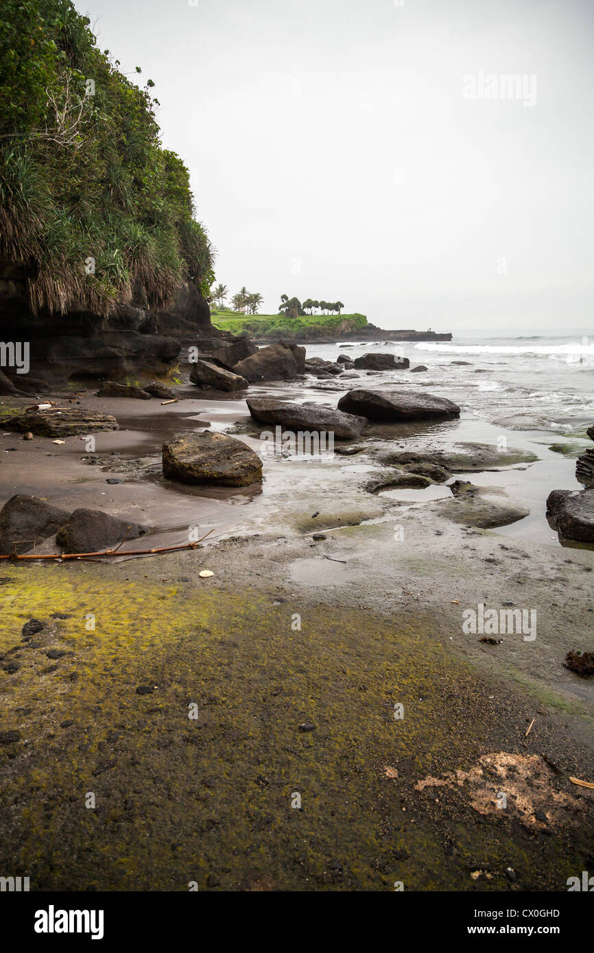 Rockbound Coast at the Temple Pura Tanah Lot on Bali - Stock Image
