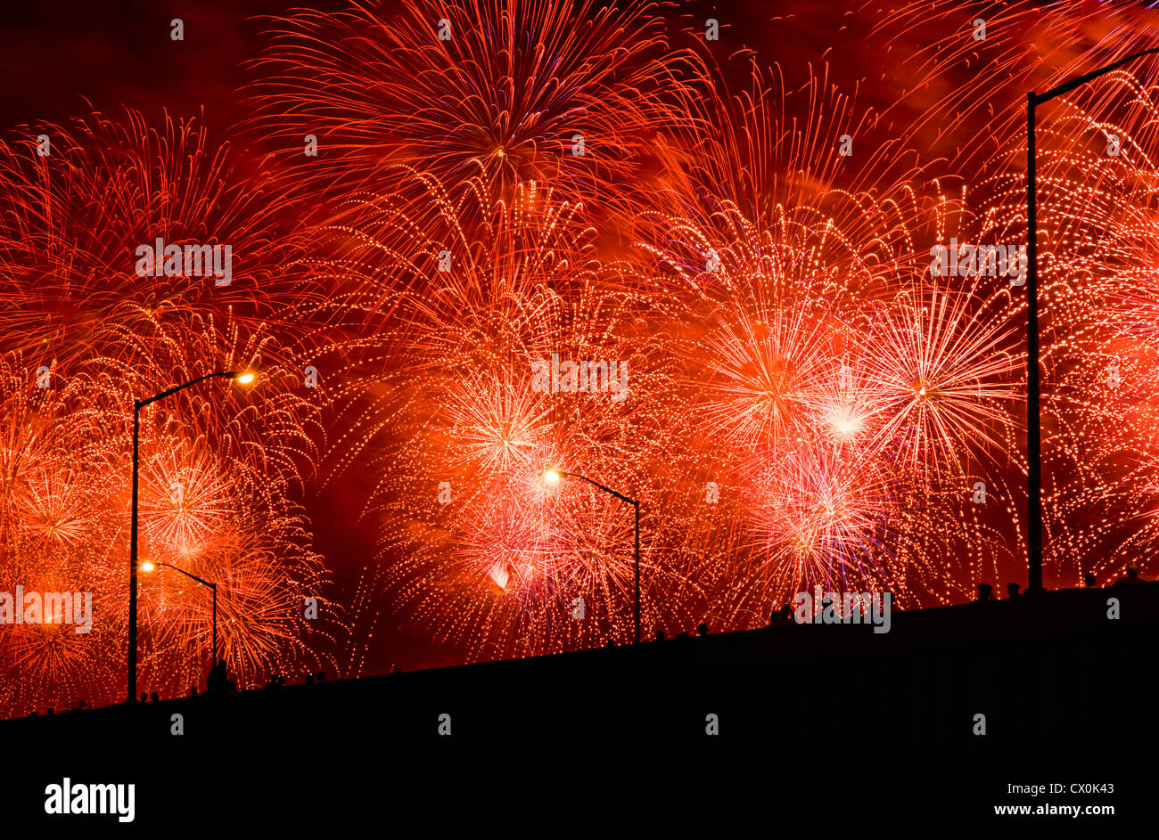 FPeople watch Fourth of July Fireworks from elevated overpass. - Stock Image