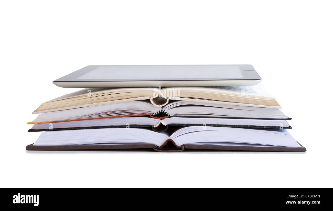 Tablet pc over open books isolated on withe - Stock Image