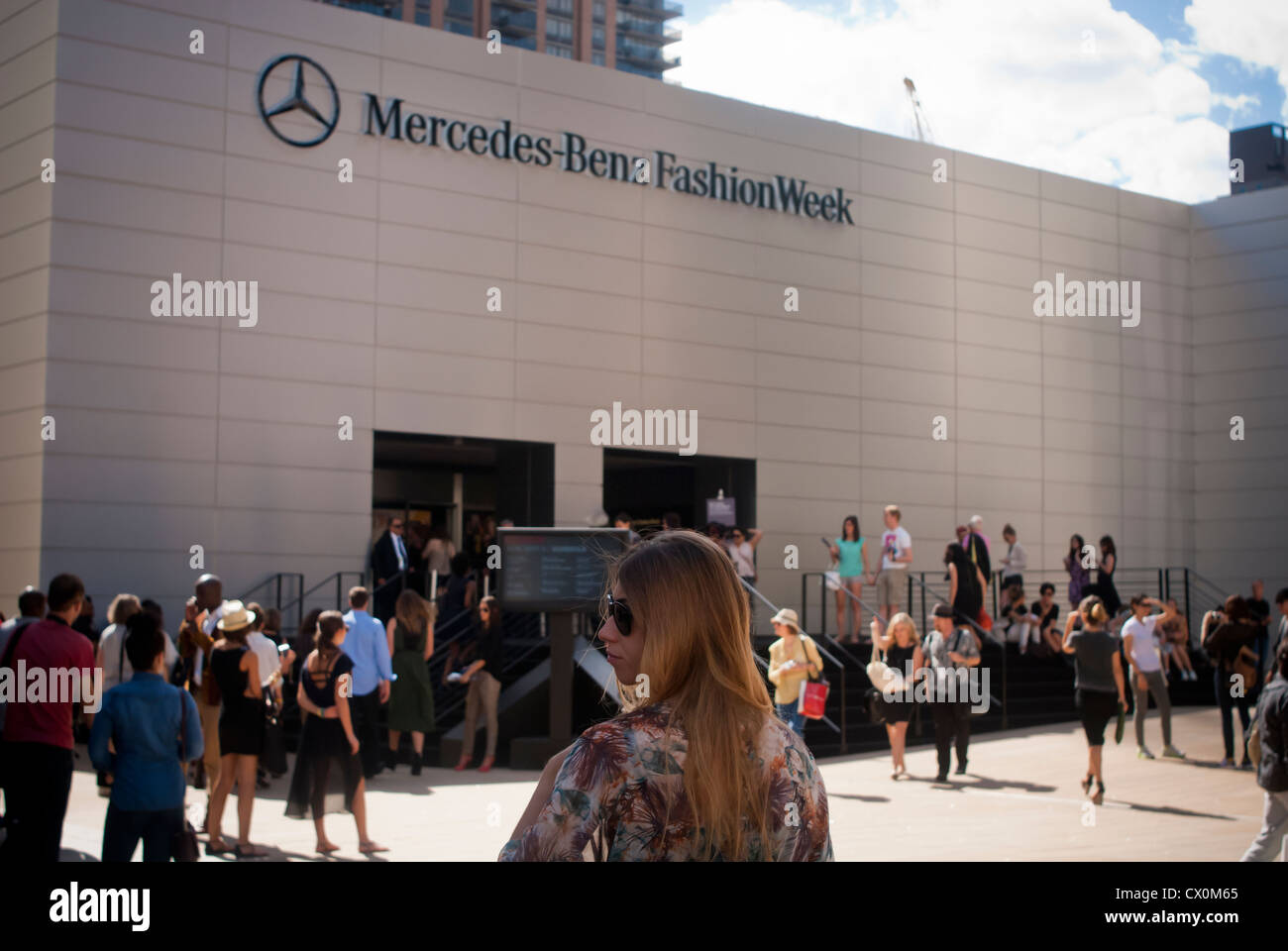 Crowds of fashionistas create a fashion scene outside of the Spring 2013 Fashion Week shows in Lincoln Center in - Stock Image