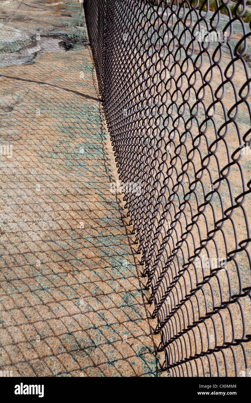 A chain link fence at the summit of  Stone Mountain, Georgia, USA - Stock Image