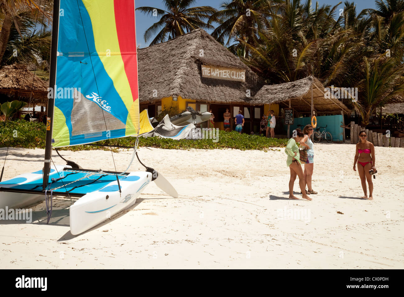 Tourists at the Water Club watersports centre, Breezes Hotel, Bwejuu, Zanzibar Africa - Stock Image