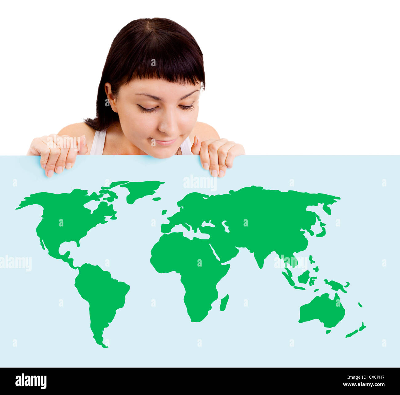 Woman smiling showing earth globe on billboard - Stock Image