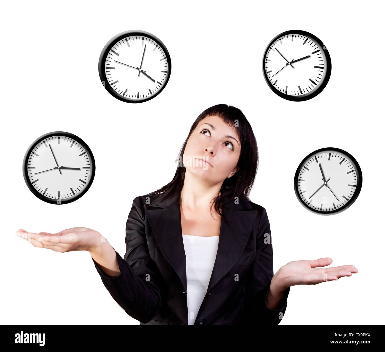 A young woman juggling the management of time. Isolated on a white background. - Stock Image