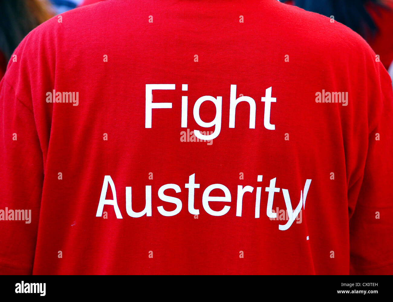 A red Fight Austerity t-shirt at the annual Toronto Labor Day Parade - Stock Image