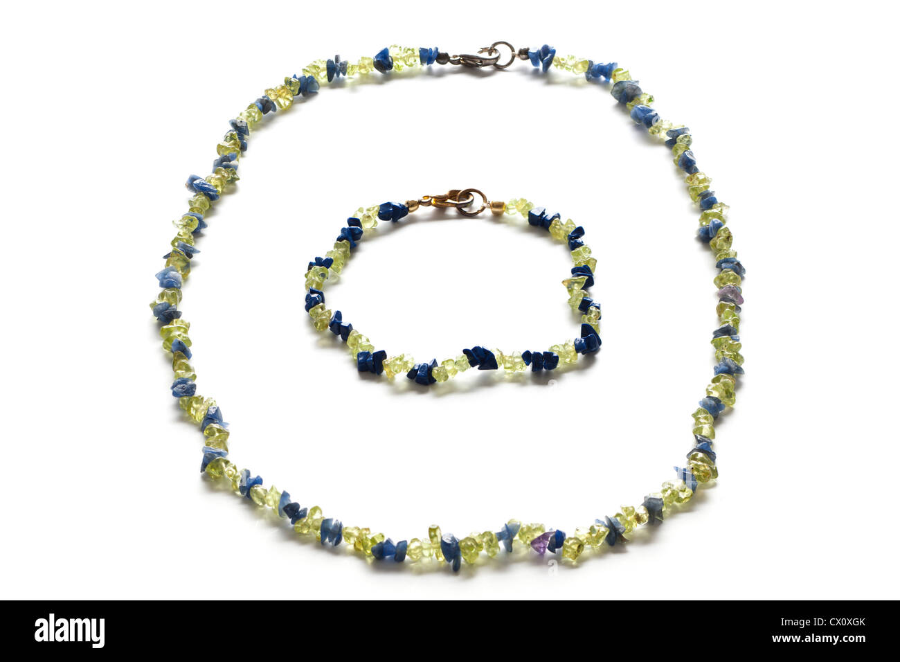 Green and blue plastic threaded bead necklace and matching bracelet - Stock Image