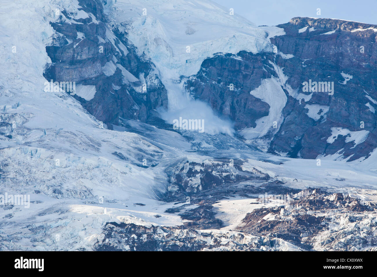 An ice fall / avalanche on the Nisqually glacier, Mount Rainier, Washington, USA. - Stock Image