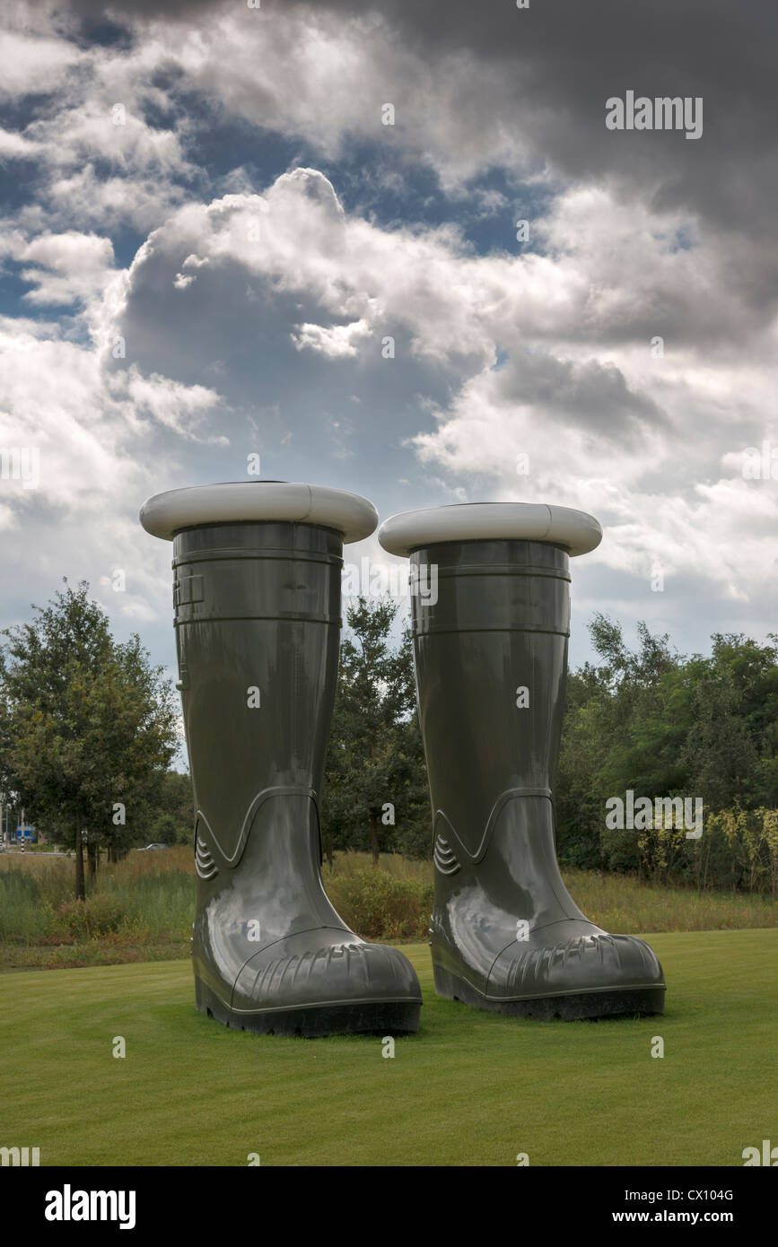 A gigantic pair of empty green wellington boots an exhibit at Floriade 2012 Netherlands Stock Photo