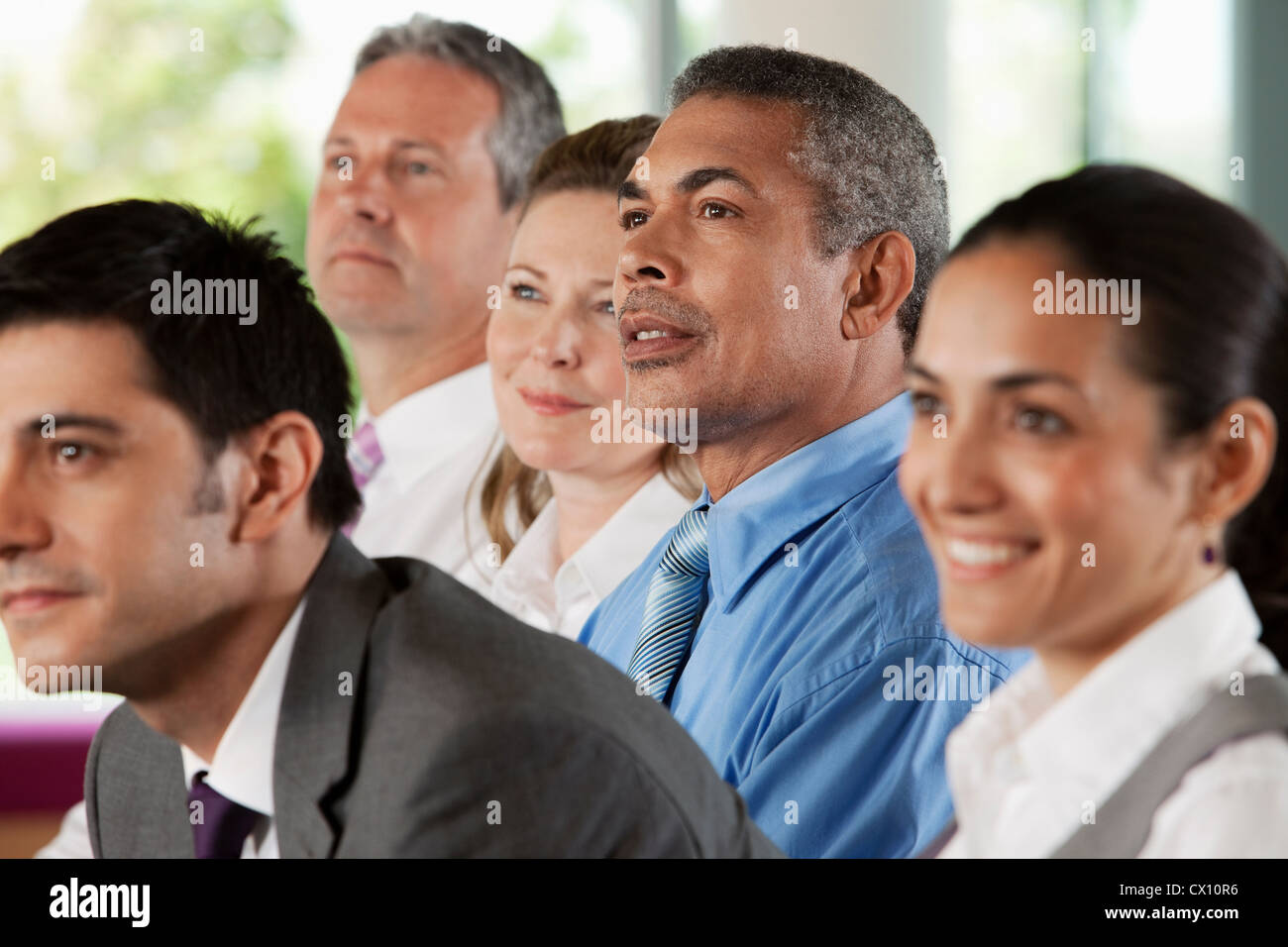 Businesspeople at presentation - Stock Image