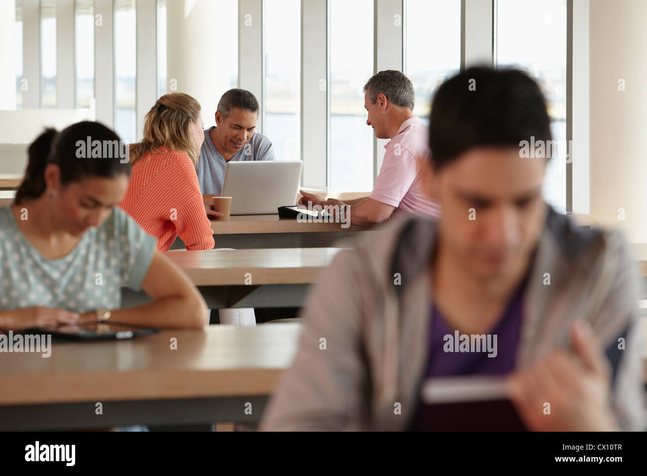 Mature students using laptop Stock Photo