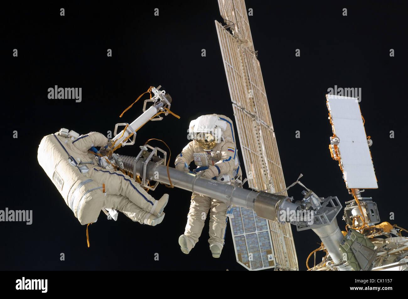 Russian cosmonauts Oleg Kononenko and Anton Shkaplerov, both Expedition 30 flight engineers during a spacewalk - Stock Image