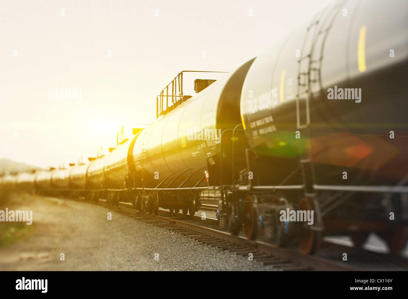 Railroad tanker cars in sunlight - Stock Image
