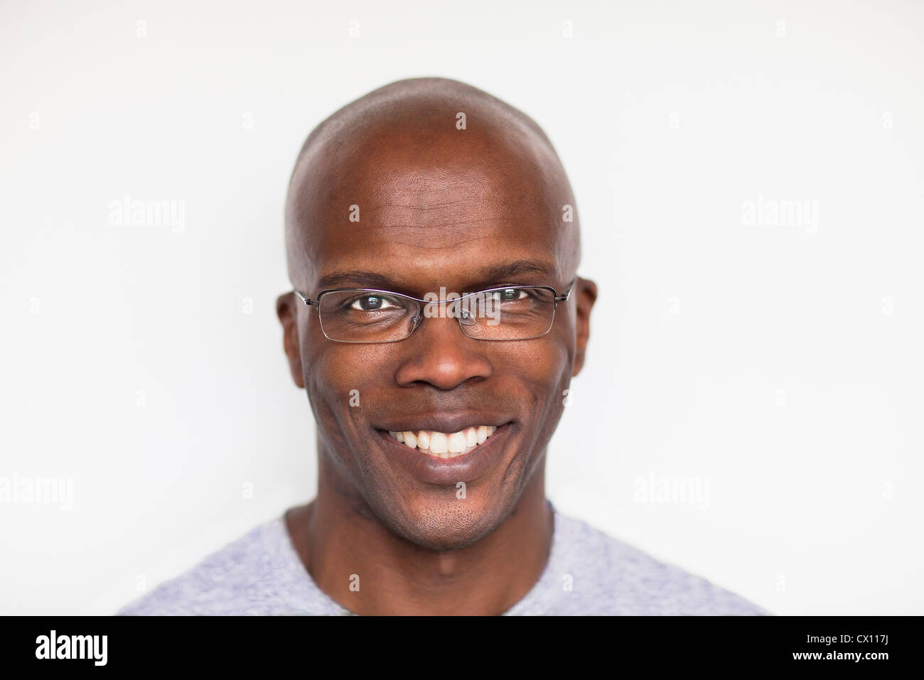 Portrait of a bald man smiling - Stock Image