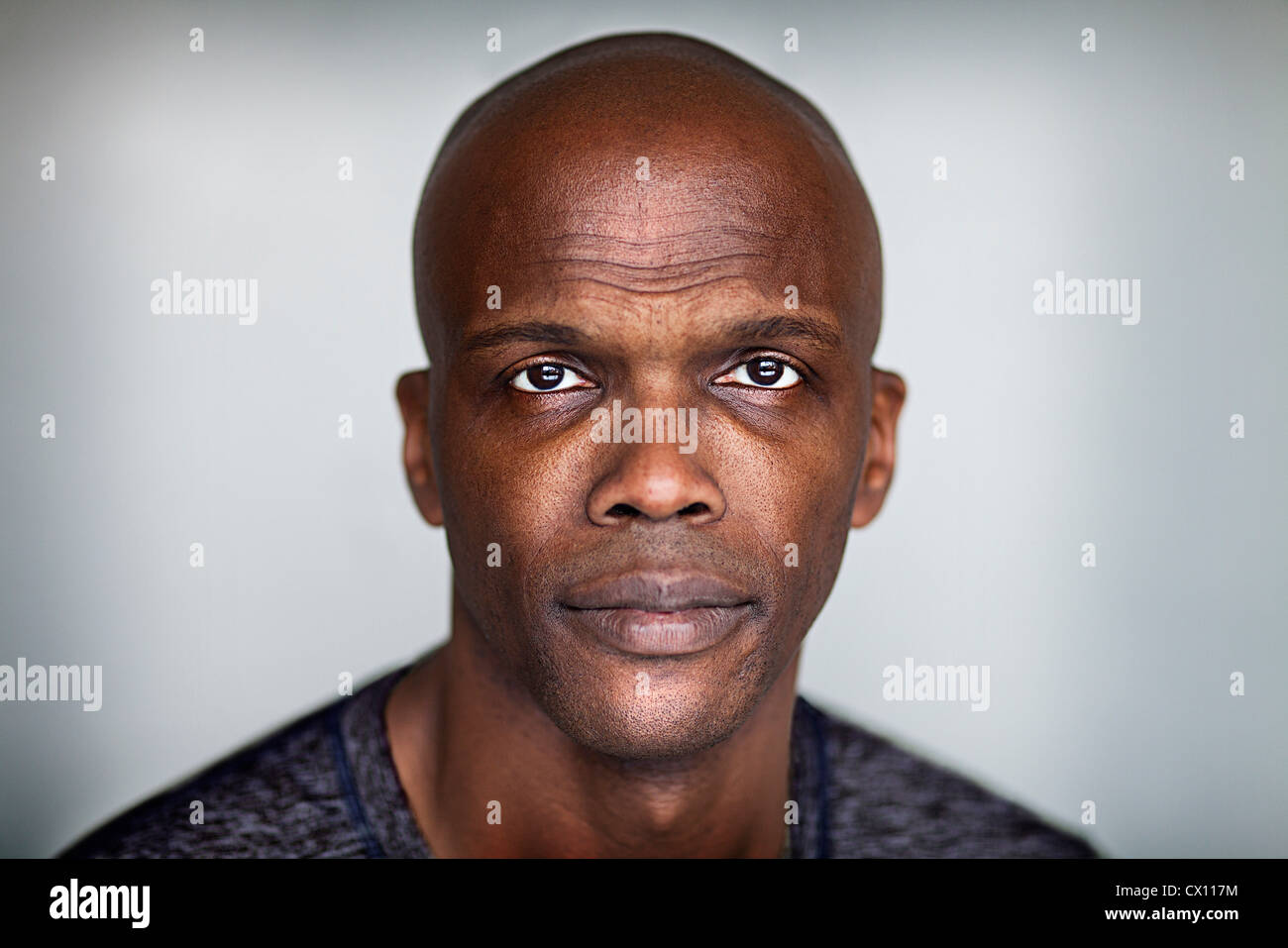 Portrait of a bald man looking at camera - Stock Image