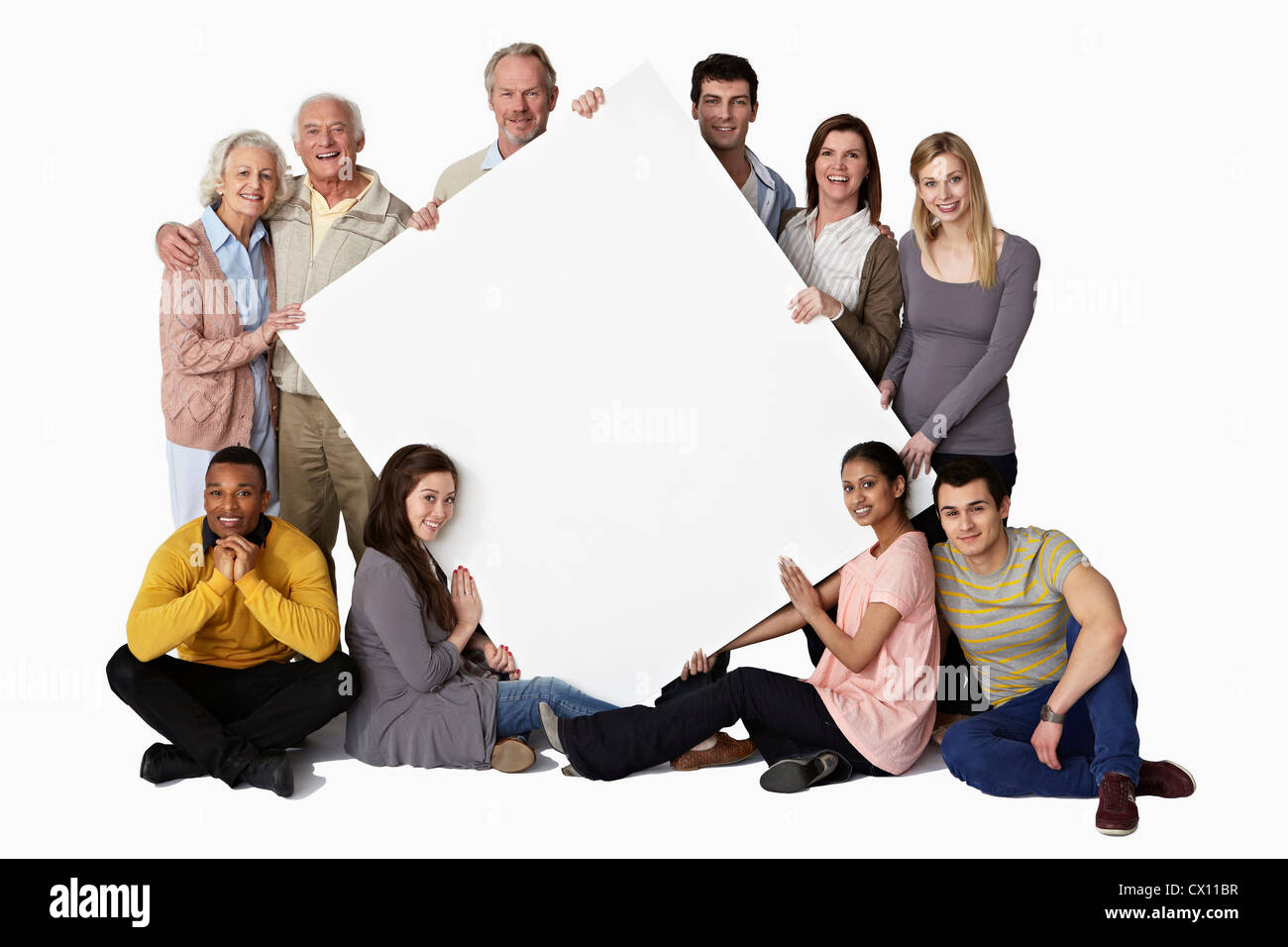Group of people holding blank notice board - Stock Image