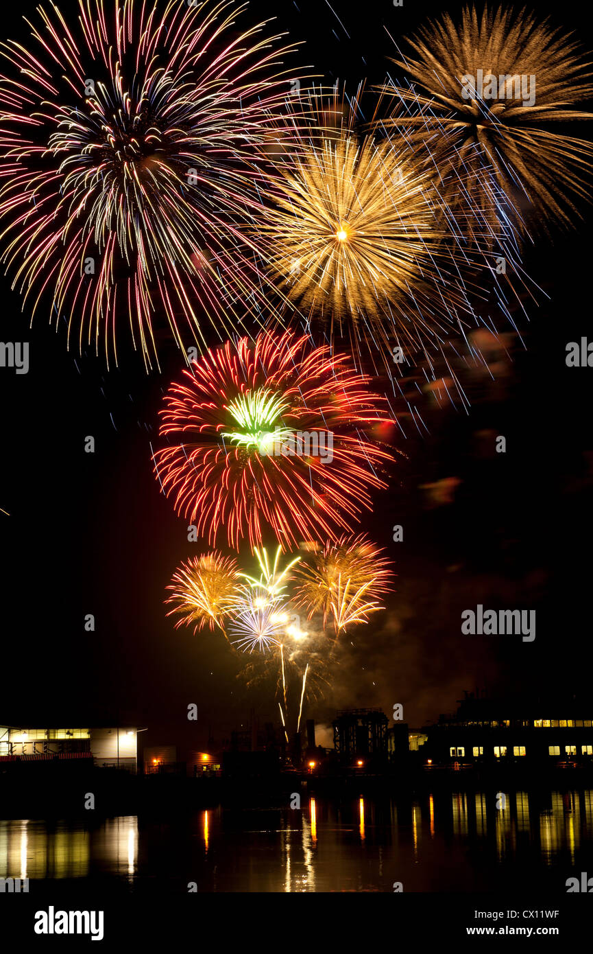 Firework display over water - Stock Image