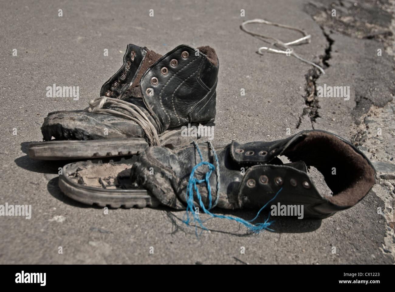 Worn out shoes, Samarkand, Uzbekistan. - Stock Image