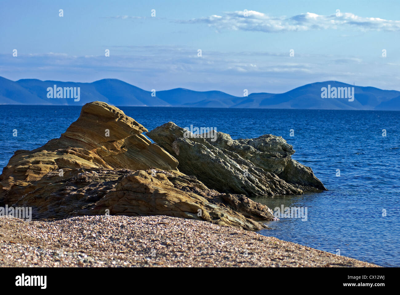Rocky beach at the Pagasitic Gulf (Pelion peninsular, Thessaly, Greece) - Stock Image