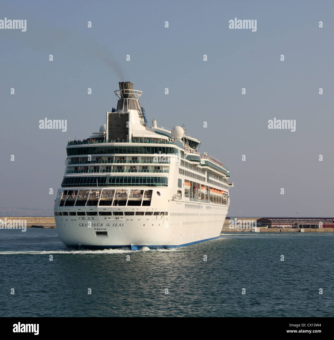 Royal Caribbean International Cruise Line 'Grandeur of the Seas' performing a pirouette during her departure - Stock Image