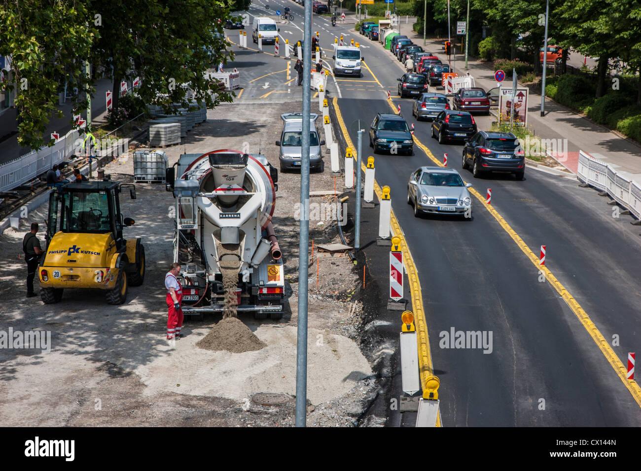Rebuilding of an inner city road. New asphalt surface. - Stock Image