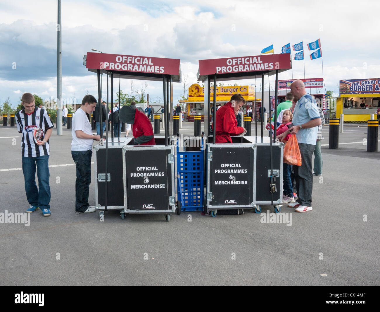 Official programme stands and sellers at Wembley Stadium London UK - Stock Image