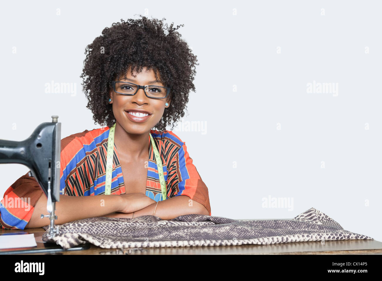 Portrait of an African American female fashion designer with sewing ...