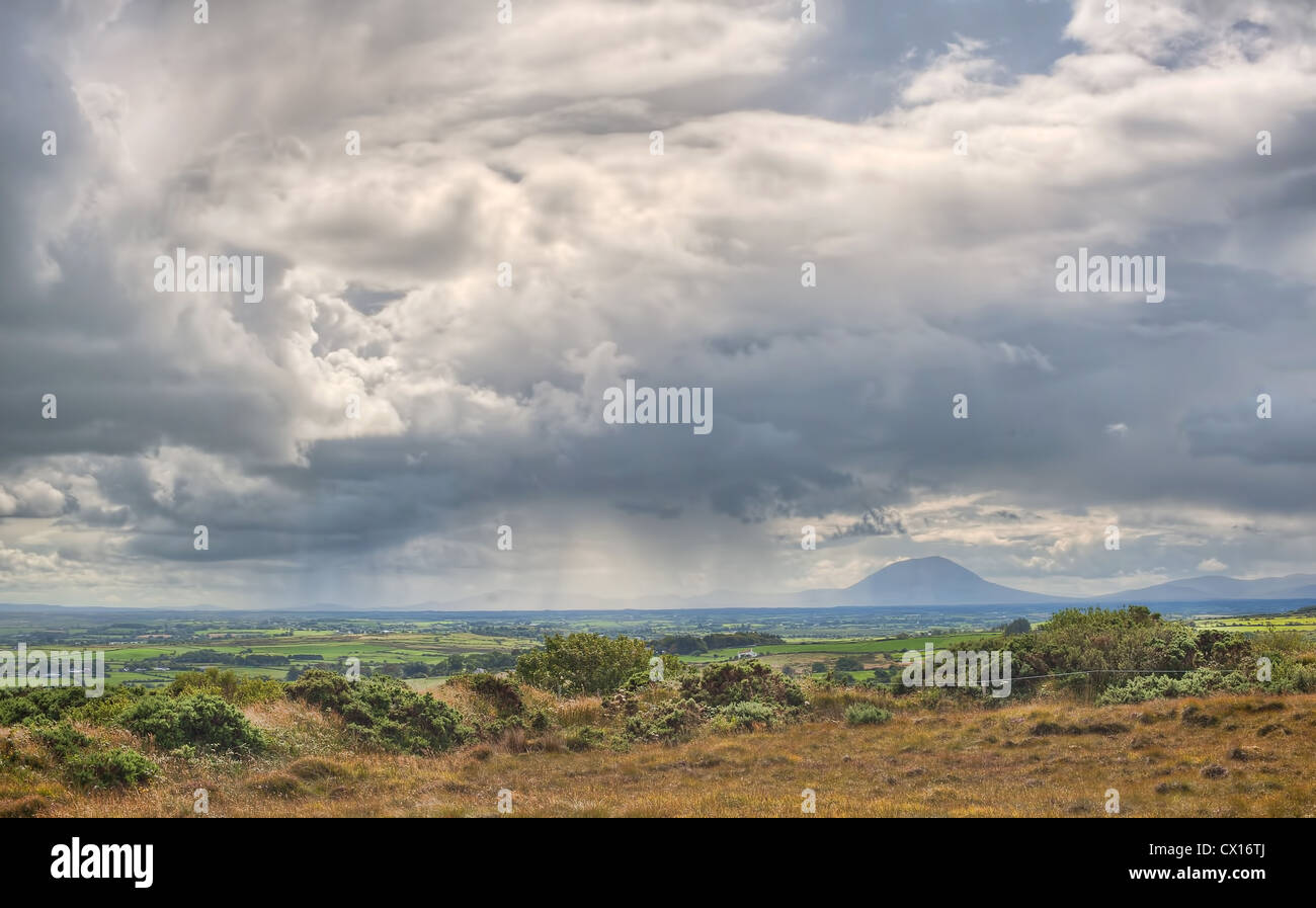 A rain shower passes by the Nephin Beg mountain in County Mayo in the West of ireland Stock Photo