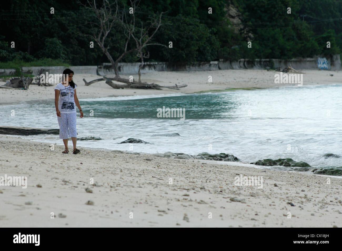 Woman strolling along the Kalapathar beach, Havelock islands, Andaman and nicobar islands - Stock Image