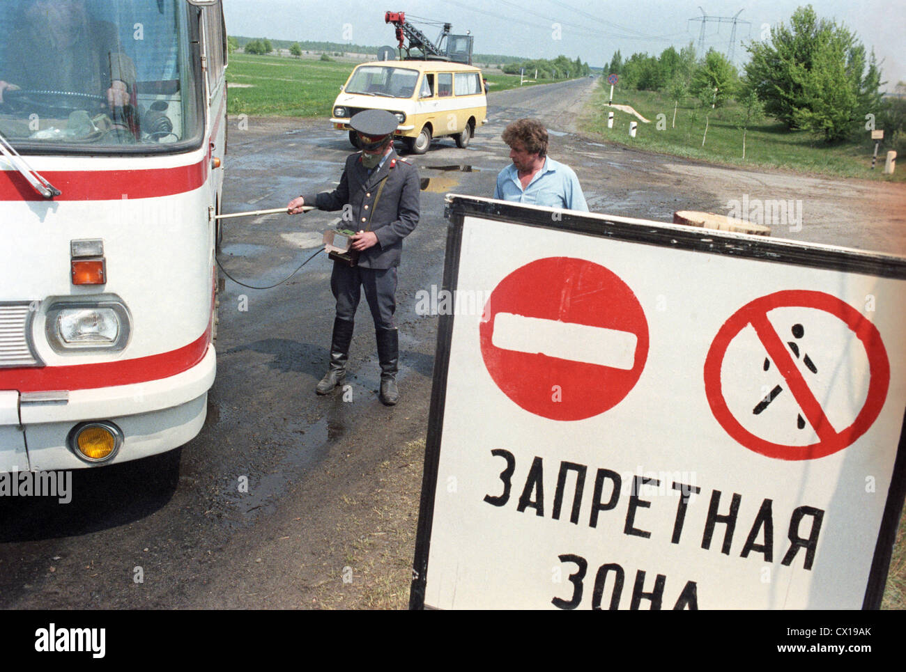 Kiev region. An officer of a dosimetric post checks transports leaving the zone of the Chernobyl disaster. Photo - Stock Image
