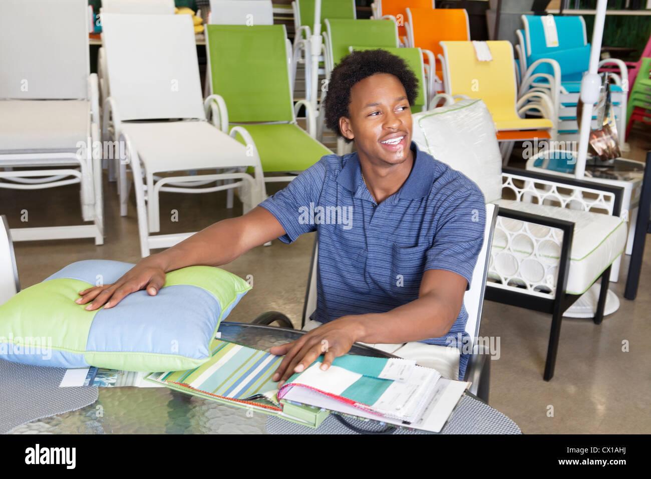 Male African American Salesperson Working In Garden Furniture Store