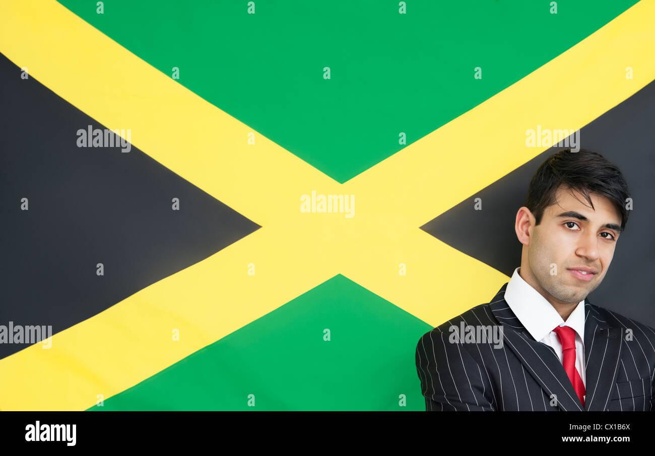 Portrait of a confident businessman against Jamaican flag - Stock Image