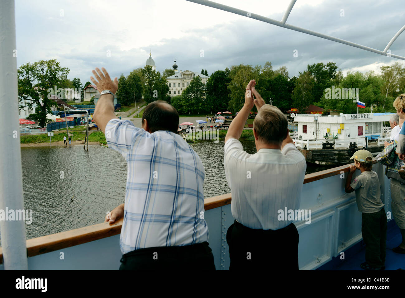 Passengers of the sailing ship say goodbye to the settlement Myshkin which  located on the river f0ab97016b732