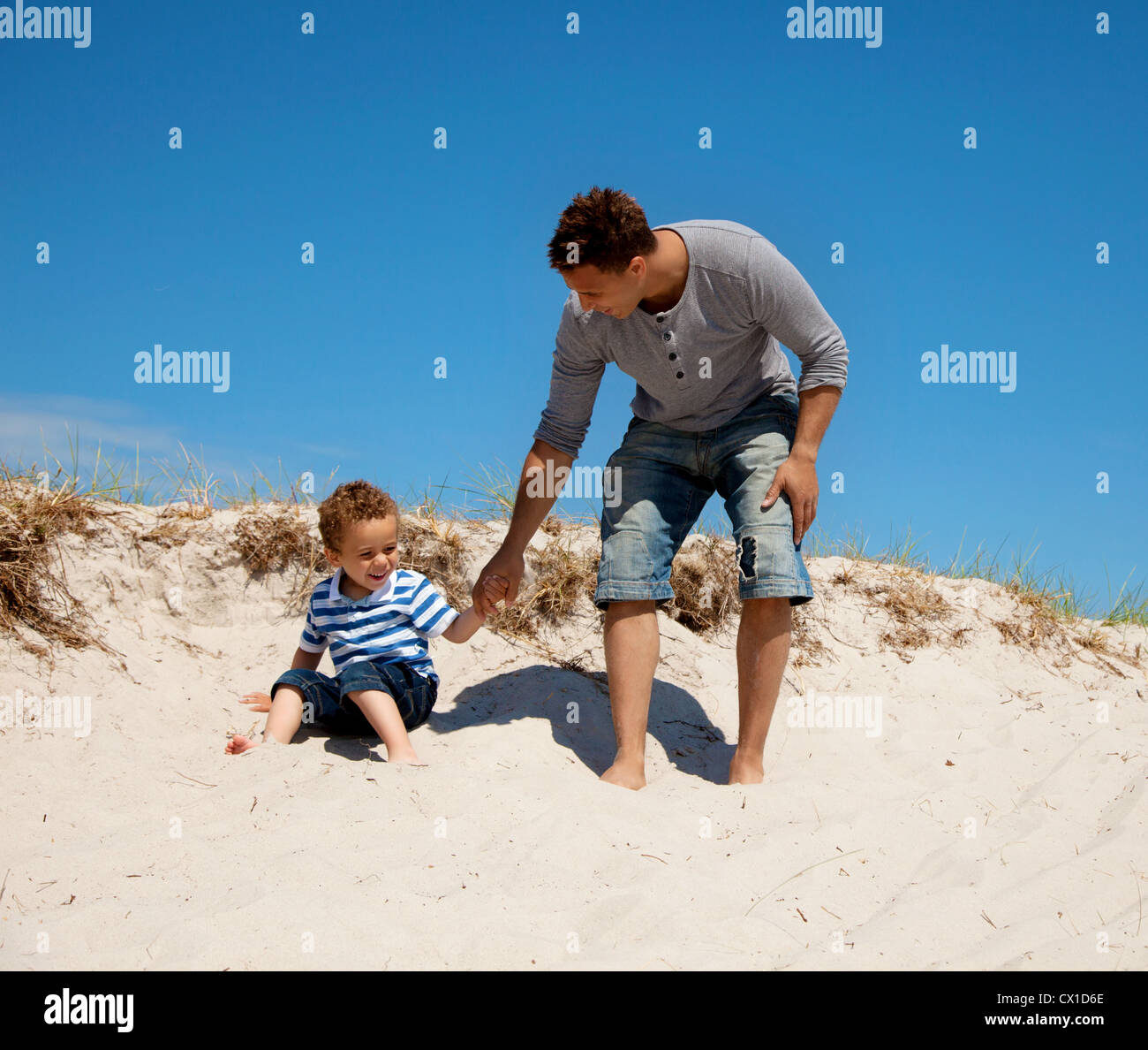 Dad and son enjoying and having fun on a sunny summer day Stock Photo