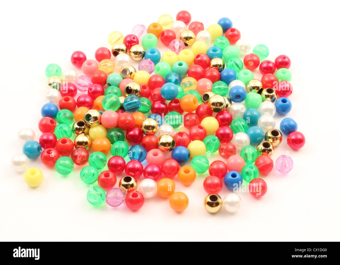 Spheres of plastic over a white background. Stock Photo