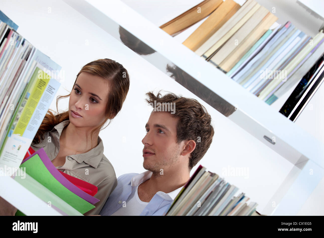 Teens in Library - Stock Image