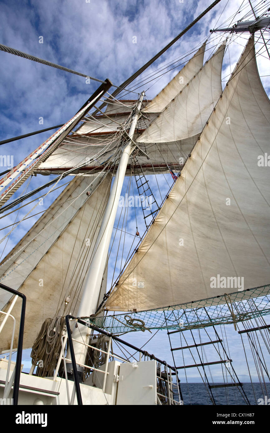 Sails, masts and rigging on board of the tall ship / barquentine Antigua sailing with tourists towards Svalbard, - Stock Image