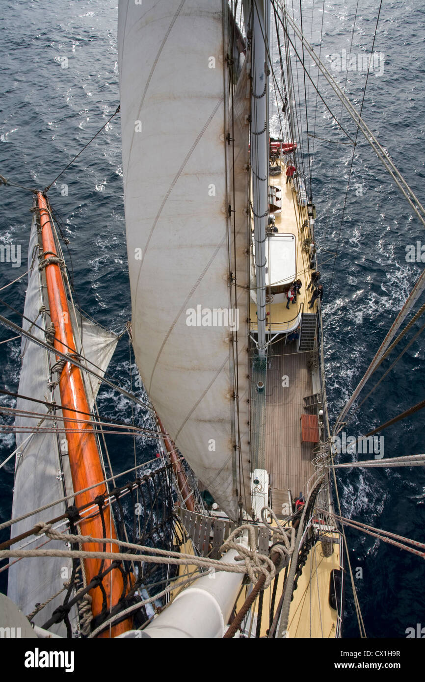 Bird's eye view on sails, rigging and deck on board of the tall ship / barquentine Antigua sailing towards Svalbard, - Stock Image
