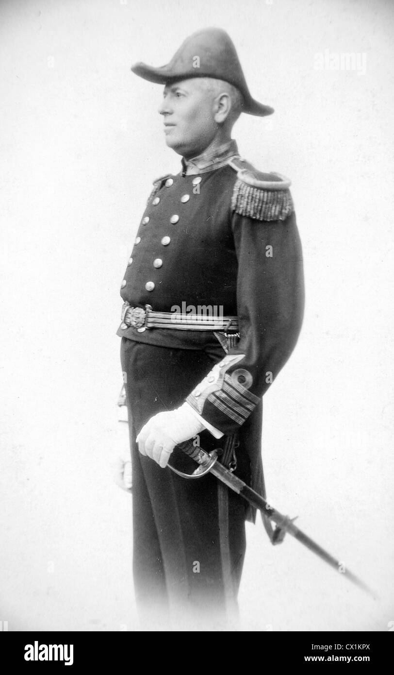Royal Navy captain in full dress uniform of Victorian and Edwardian era. - Stock Image