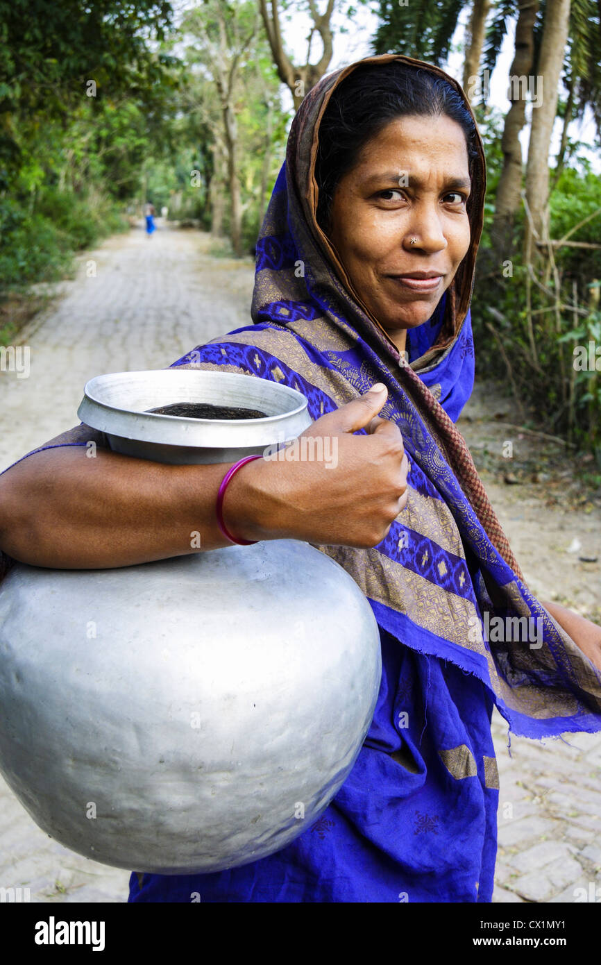 Portrait of woman with sari carrying water pitcher in Bagerhat , Bangladesh - Stock Image