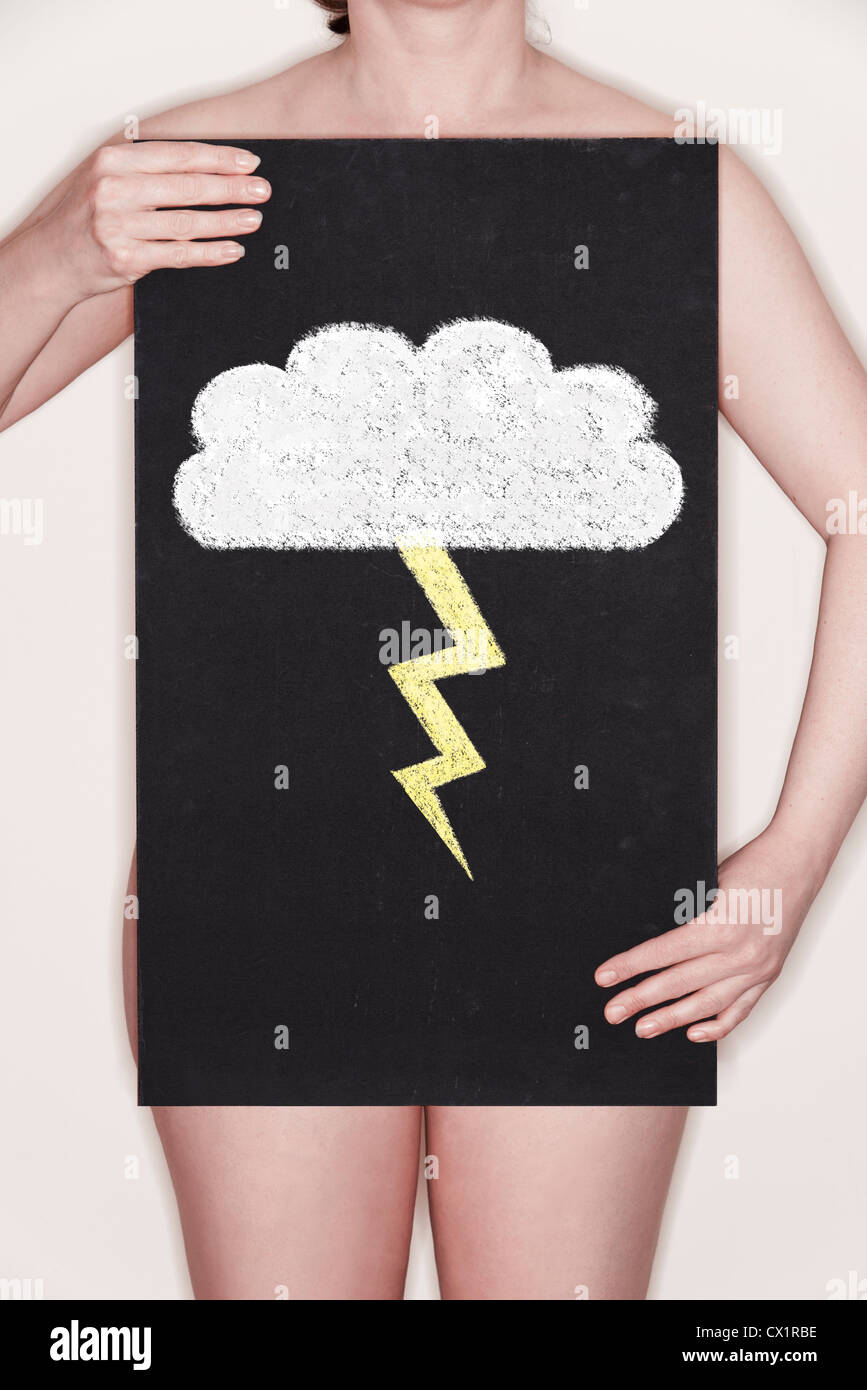 Woman holding a blackboard with a chalk illustration of a Cloud and Lightning Bolt on it  - Concept image - Stock Image