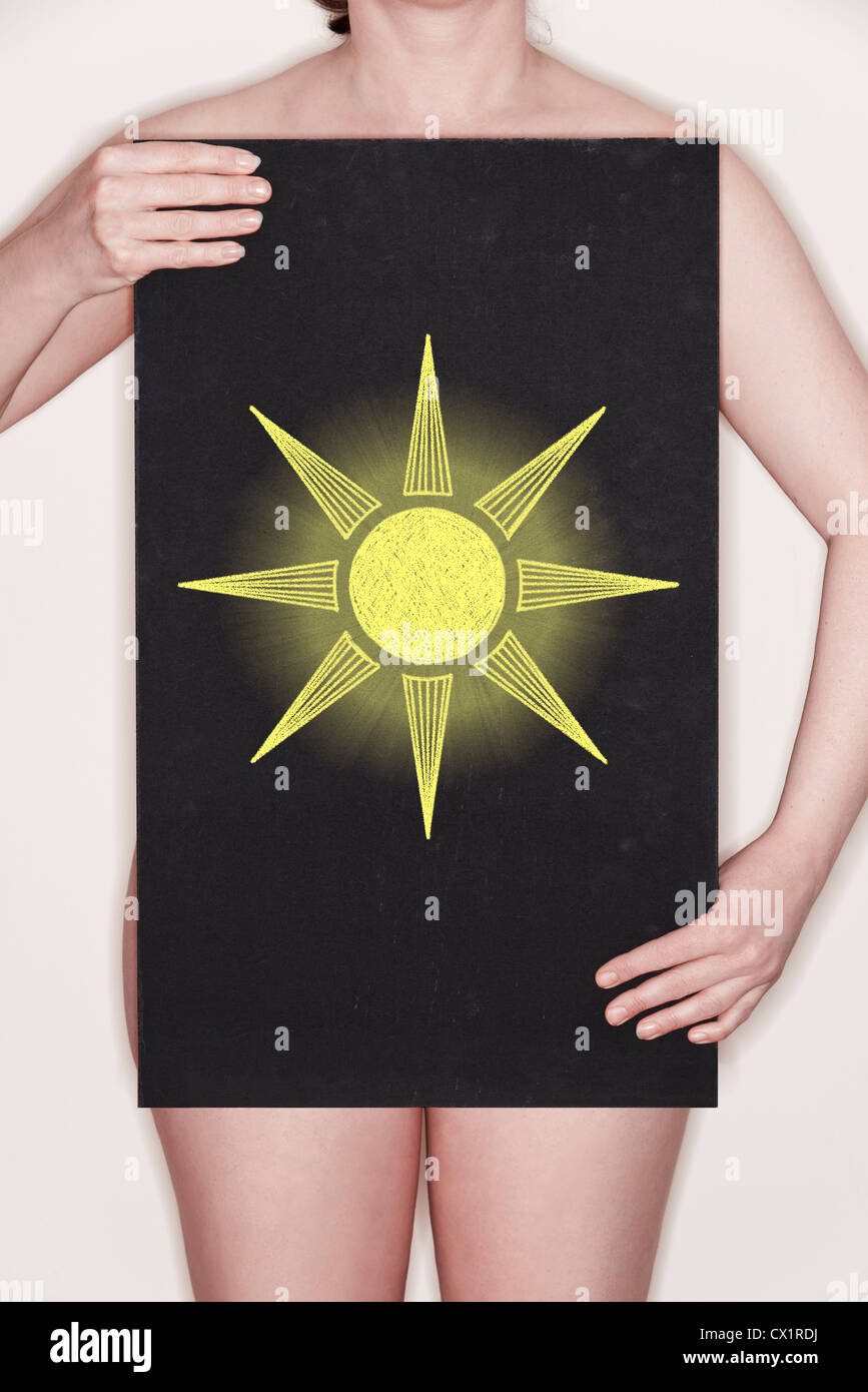 Woman holding a blackboard with a chalk illustration of a Sun on it  - Concept image - Stock Image