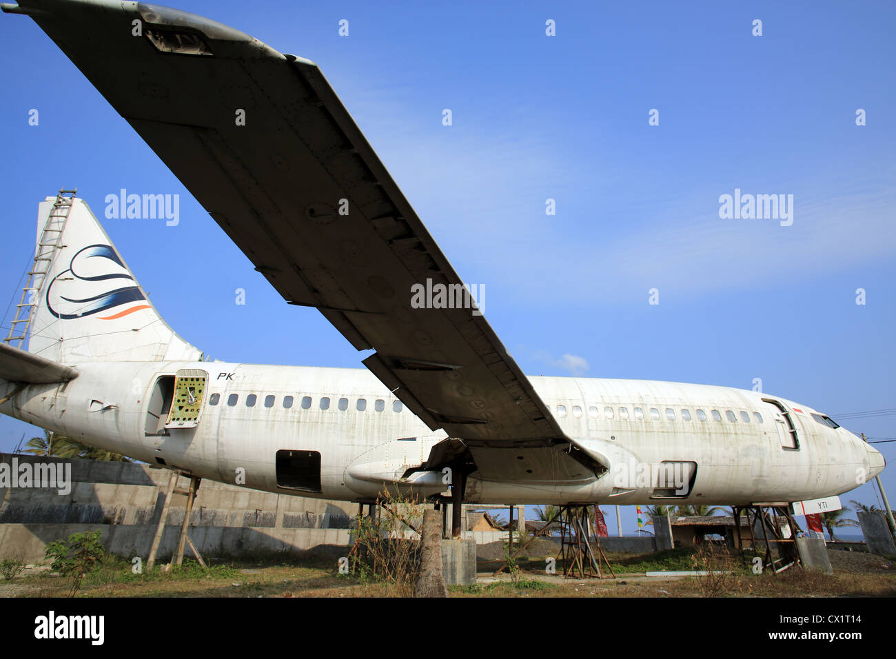 Abandoned fuselage of a jet passenger airliner. - Stock Image